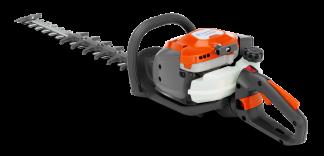 Oranžas Husqvarna Dzīvžogu šķēres, modelis ''522HD60X'', skats no aizmugures kreisās puses