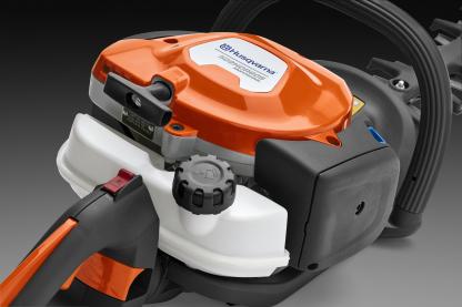 Oranžas Husqvarna Dzīvžogu šķēres, modelis ''522HDR60X'', skats no aizmugures kreisās puses