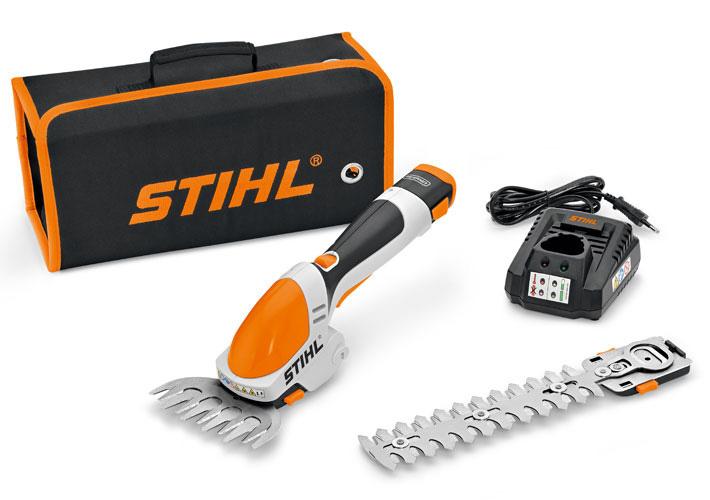 Oranžs, balts Stihl Akumulatora krūmu un zāles šķēres, modelis ''HSA 25'', komplektācija ar aksesūriem ( maināms asmens, soma, akumulatora lādētājs)